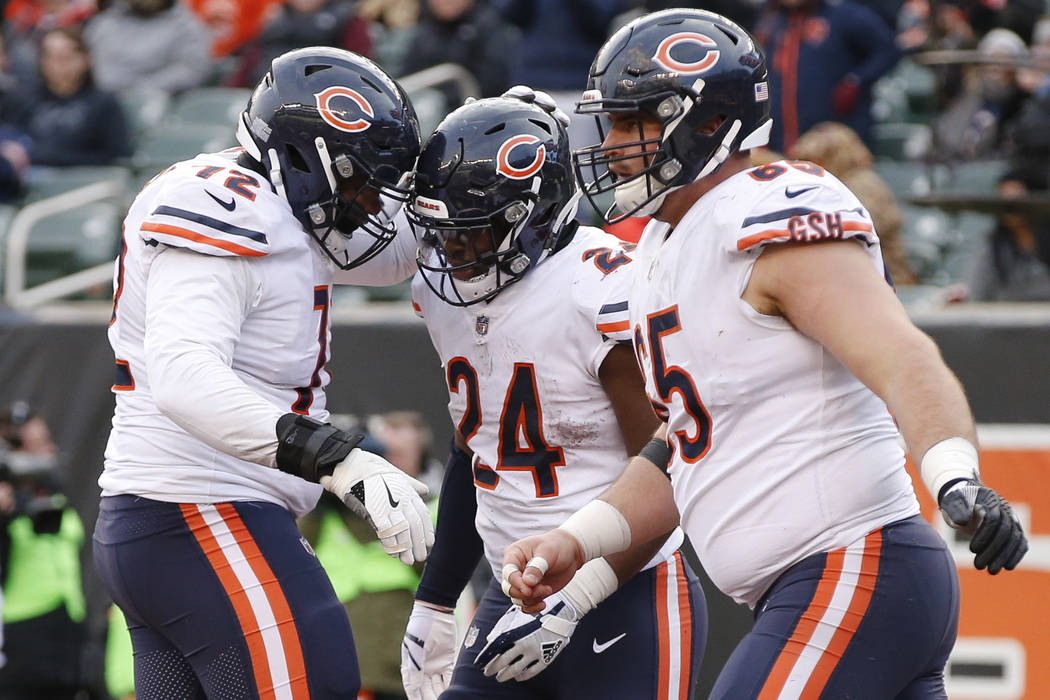 Chicago Bears running back Jordan Howard (24) celebrates his touchdown with wide receiver Markus Wheaton (12) in the second half of an NFL football game, Sunday, Dec. 10, 2017, in Cincinnati. (AP  ...