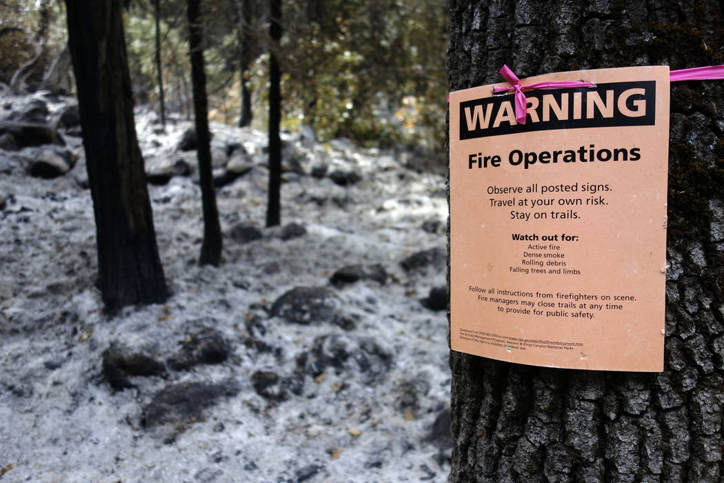A sign warns visitors of controlled-fire operations in Kings Canyon National Park, Calif.  (AP Photo/Brian Melley)