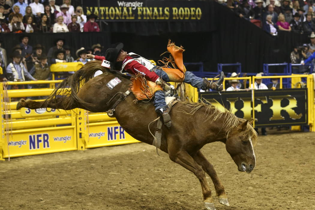 Clayton Biglow of Clements, California rides South Suds in the bareback riding competition during the eighth go-round of the National Finals Rodeo, Thursday, Dec. 14, 2017, at the Thomas & Mac ...
