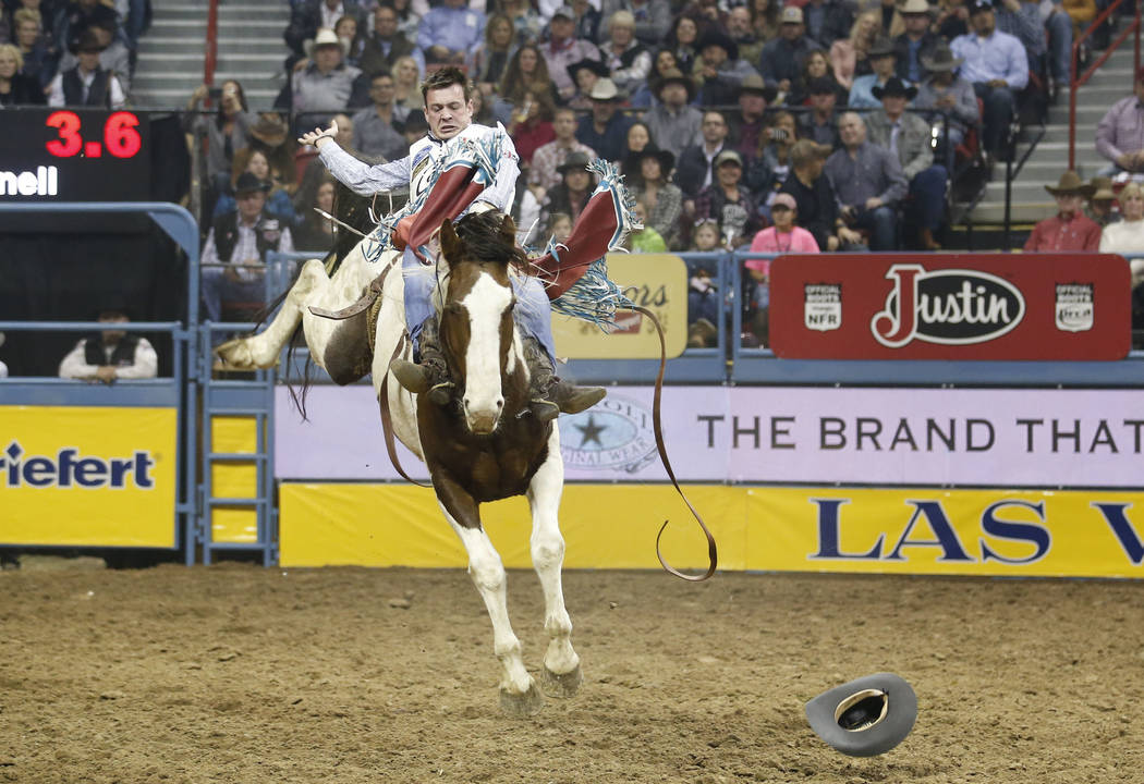 Tim O'Connell of Zwingle, Iowa rides Feather Fluffer in the bareback riding competition during the ninth go-round of the National Finals Rodeo, Friday, Dec. 15, 2017, at the Thomas & Mack Cent ...