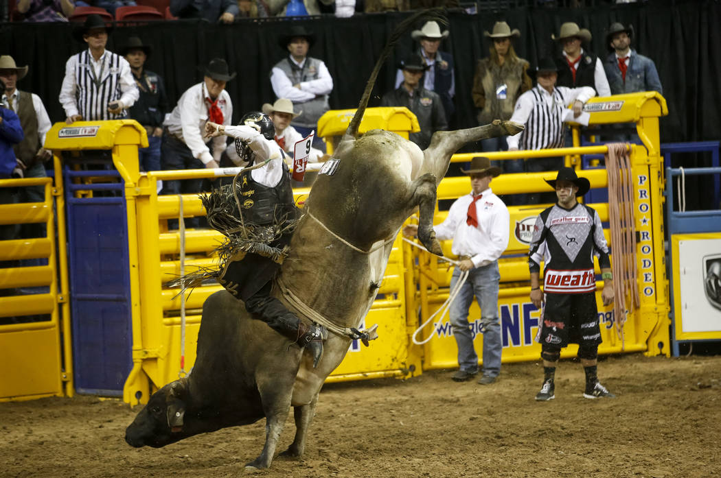 Sage Kimzey of Strong City, Oklahoma rides Jack Shot in the bull riding competition during the ninth go-round of the National Finals Rodeo, Friday, Dec. 15, 2017, at the Thomas & Mack Center i ...