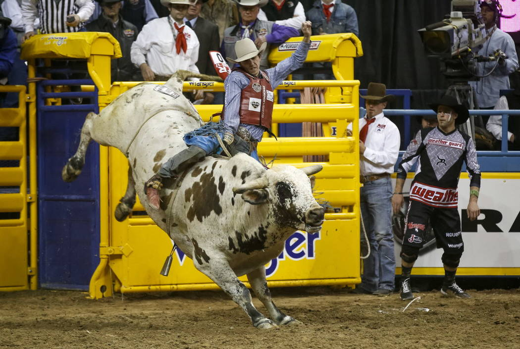 Roscoe Jarboe of New Plymouth, Idaho rides JBC Teckno Crepe in the bull riding competition during the ninth go-round of the National Finals Rodeo, Friday, Dec. 15, 2017, at the Thomas & Mack C ...