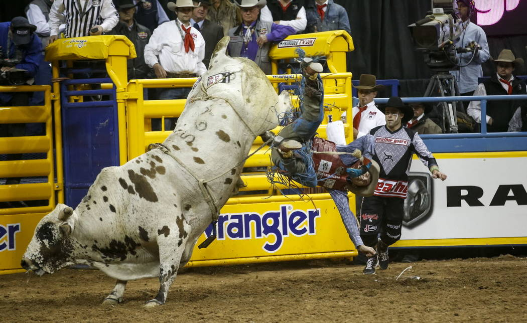 Roscoe Jarboe of New Plymouth, Idaho is bucked from JBC Teckno Crepe in the bull riding competition during the ninth go-round of the National Finals Rodeo, Friday, Dec. 15, 2017, at the Thomas &am ...