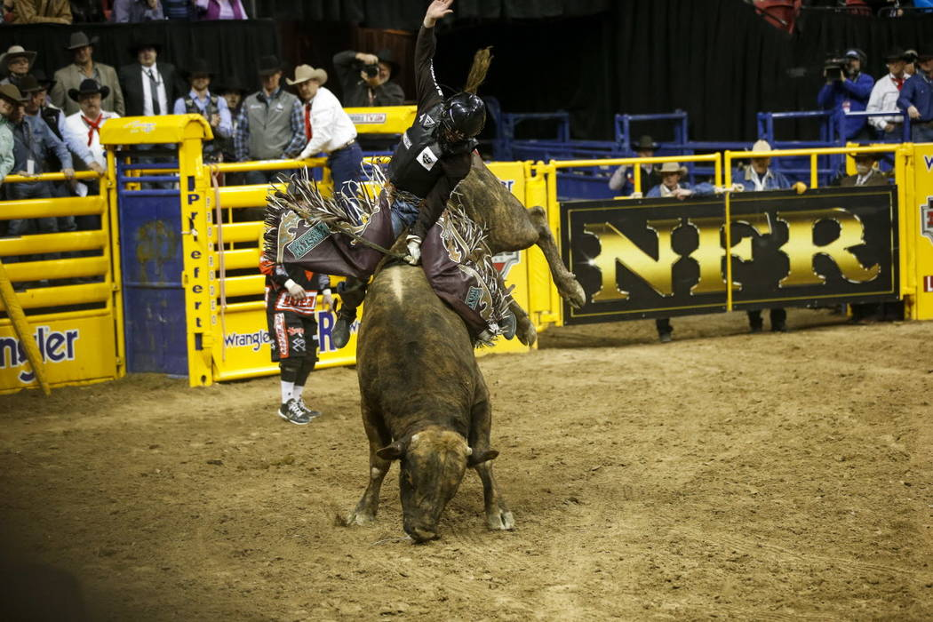 Boudreaux Campbell of Crockett, Texas rides Reveloution in the bull riding competition during the ninth go-round of the National Finals Rodeo, Friday, Dec. 15, 2017, at the Thomas & Mack Cente ...