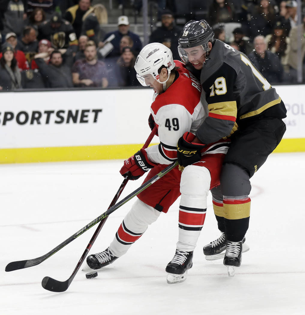Carolina Hurricanes center Victor Rask (49) and Vegas Golden Knights right wing Reilly Smith get wrapped up during the third period of an NHL hockey game Tuesday, Dec. 12, 2017, in Las Vegas. (AP  ...