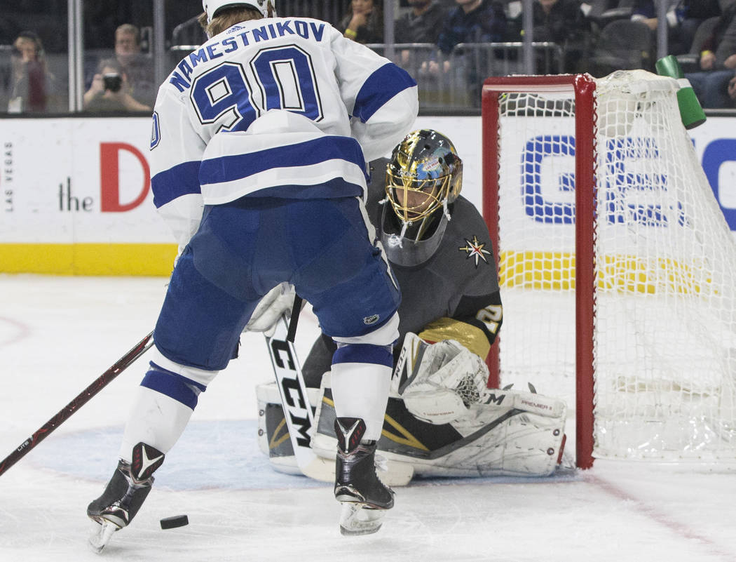 Golden Knights goaltender Marc-Andre Fleury (29) makes a save against Tampa Bay center Vladislav Namestnikov (90) in the first period during Vegas' home matchup with the Lighting on Tuesday, Dec.  ...