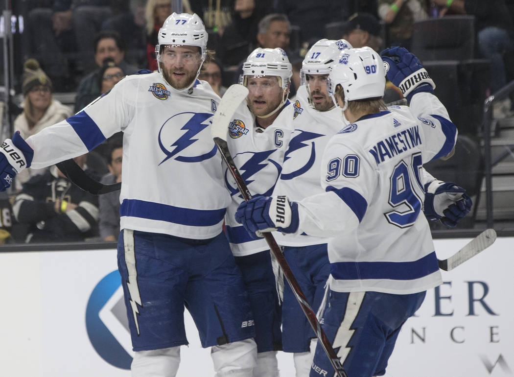 Tampa Bay center Vladislav Namestnikov (90) celebrates with teammates after the Lighting scored their first goal of the night on Tuesday, Dec. 19, 2017, at T-Mobile Arena, in Las Vegas. Benjamin H ...