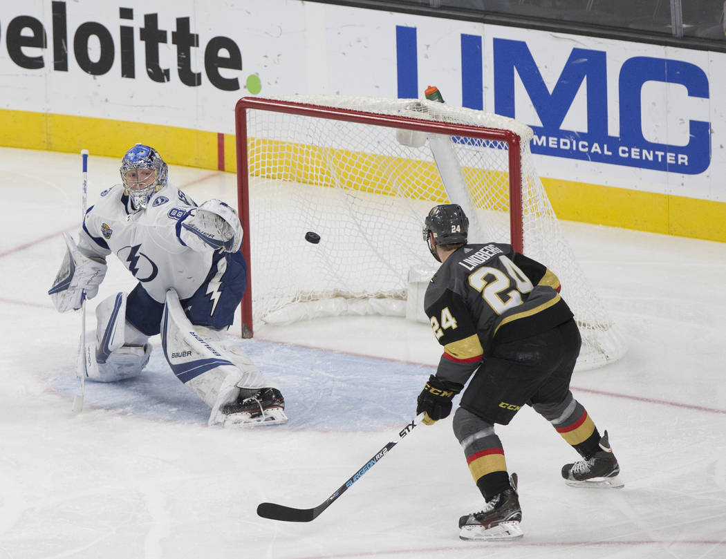 Tampa Bay goaltender Andrei Vasilevskiy  (88) makes a save against Golden Knights center Oscar Lindberg (24) in the second period during the Lightning's road matchup with Vegas on Tuesday, Dec. 19 ...