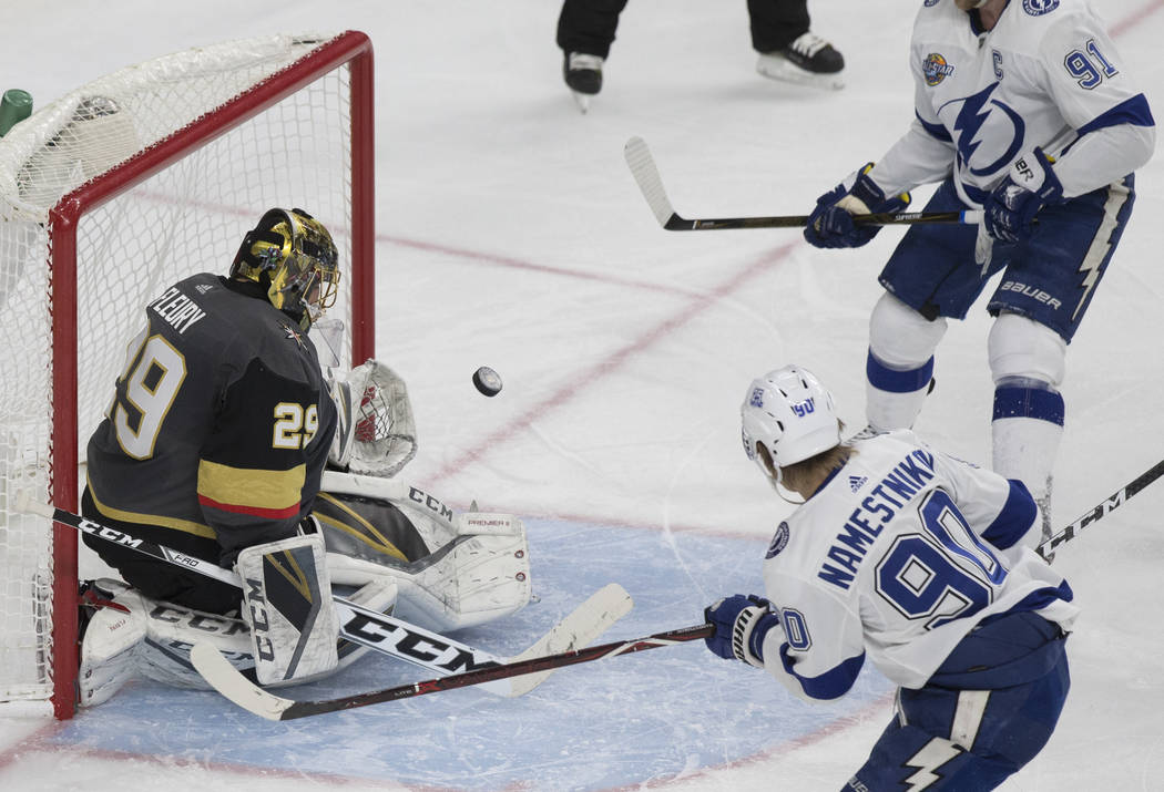 Golden Knights goaltender Marc-Andre Fleury (29) makes a save against Tampa Bay center Vladislav Namestnikov (90) in the second during Vegas' home matchup with the Lighting on Tuesday, Dec. 19, 20 ...