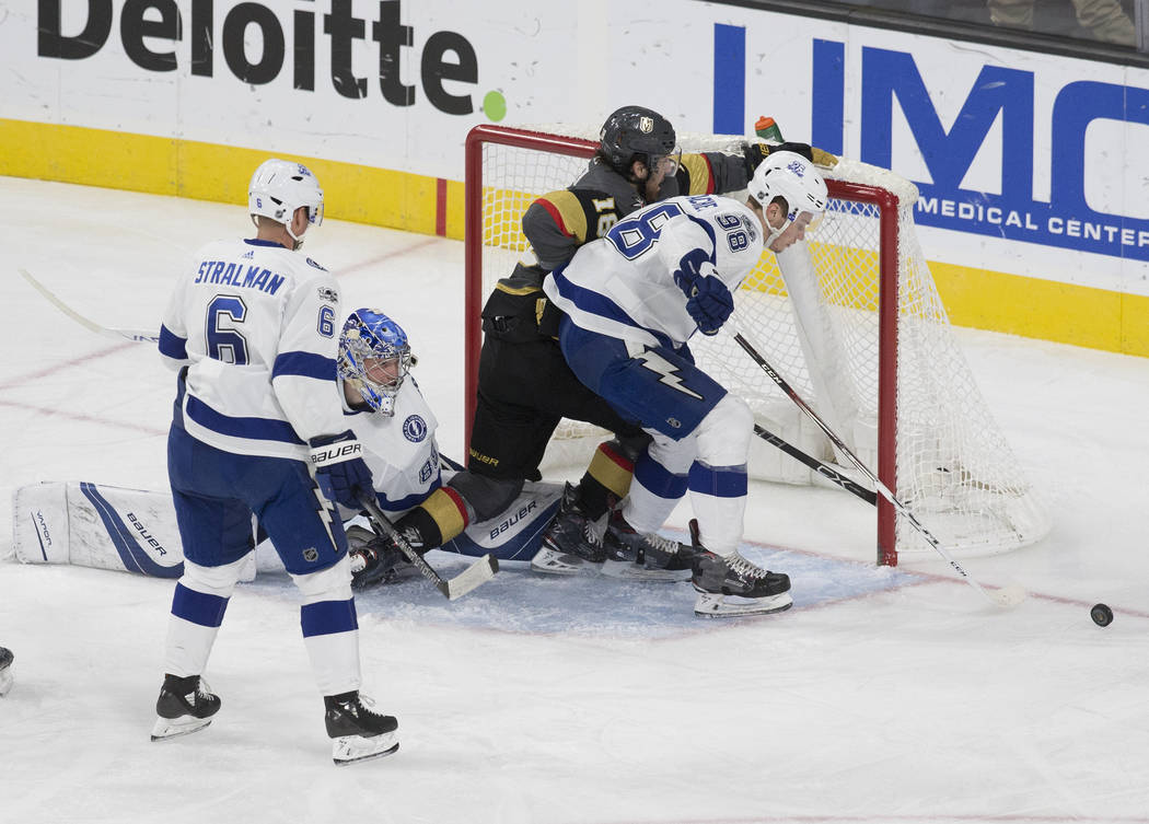 Tampa Bay goaltender Andrei Vasilevskiy  (88) and defenseman Mikhail Sergachev (98) blok the shot of Golden Knights left wing James Neal (18) in the second period during the Lightning's road match ...