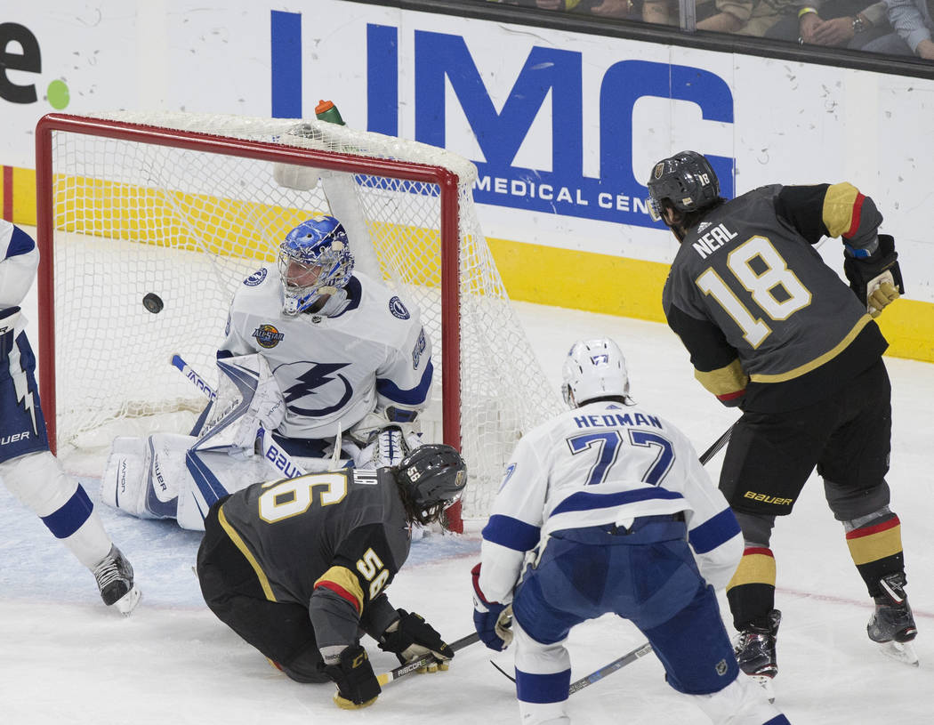 Golden Knights left wing James Neal (18) beats Tampa Bay goaltender Andrei Vasilevskiy (88) in the second period during Vegas' home matchup with the Lighting on Tuesday, Dec. 19, 2017, at T-Mobile ...