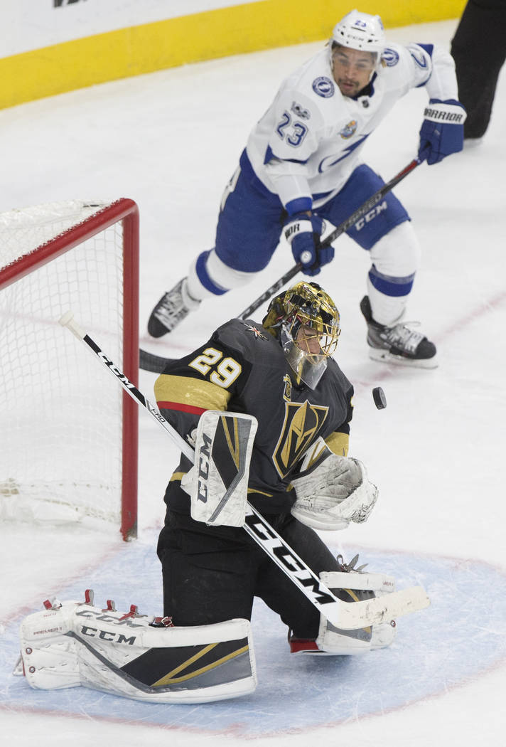 Golden Knights goaltender Marc-Andre Fleury (29) makes a save against Tampa Bay right wing J.T. Brown                  (23) in the second during Vegas' home matchup with the Lighting on Tuesday, D ...