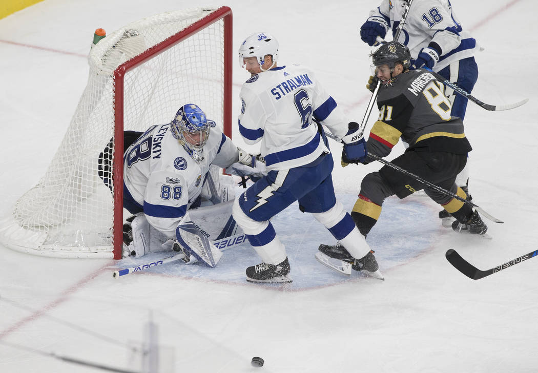 Tampa Bay goaltender Andrei Vasilevskiy (88) makes a save against Golden Knights center Jonathan Marchessault (81) in the third period during the Lightning's road matchup with Vegas on Tuesday, De ...