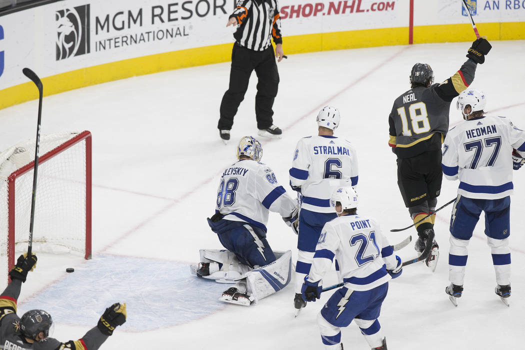 Golden Knights left wing James Neal (18) celebrates after teammate Shea Theodore (27) scored the go ahead goal in the third period during Vegas' home matchup with the Tampa Bay Lighting on Tuesday ...