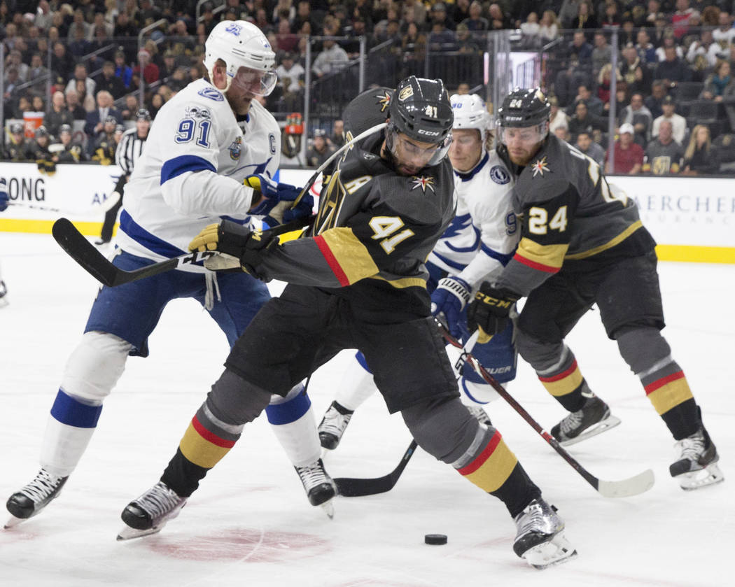 Golden Knights left wing Pierre-Edouard Bellemare (41) beats Tampa Bay center Steven Stamkos (91) in the first period during Vegas' home matchup with the Lighting on Tuesday, Dec. 19, 2017, at T-M ...