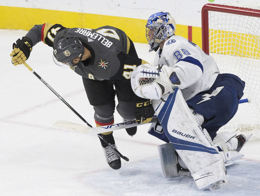 Golden Knights left wing Pierre-Edouard Bellemare (41) collides with Tampa Bay goaltender Andrei Vasilevskiy (88) in the second period during Vegas' home matchup with the Lighting on Tuesday, Dec. ...