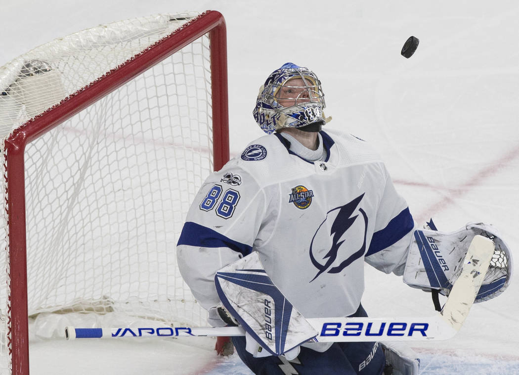 Tampa Bay goaltender Andrei Vasilevskiy (88) makes a save in the second period during the Lightning's road matchup with the Golden Knights on Tuesday, Dec. 19, 2017, at T-Mobile Arena, in Las Vega ...