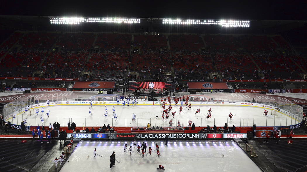 Montreal Canadiens and Ottawa Senators warm up on the ice prior to action at the NHL hockey 100 Classic, in Ottawa on Saturday, Dec. 16, 2017. (Sean Kilpatrick/The Canadian Press via AP)