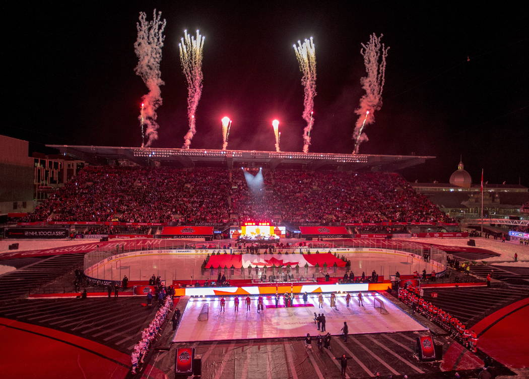 Fireworks go off during the ceremonies before hockey action between the Ottawa Senators and Montreal Canadiens at the NHL 100 Classic, in Ottawa on Saturday, Dec. 16, 2017. (Sean Kilpatrick/The Ca ...