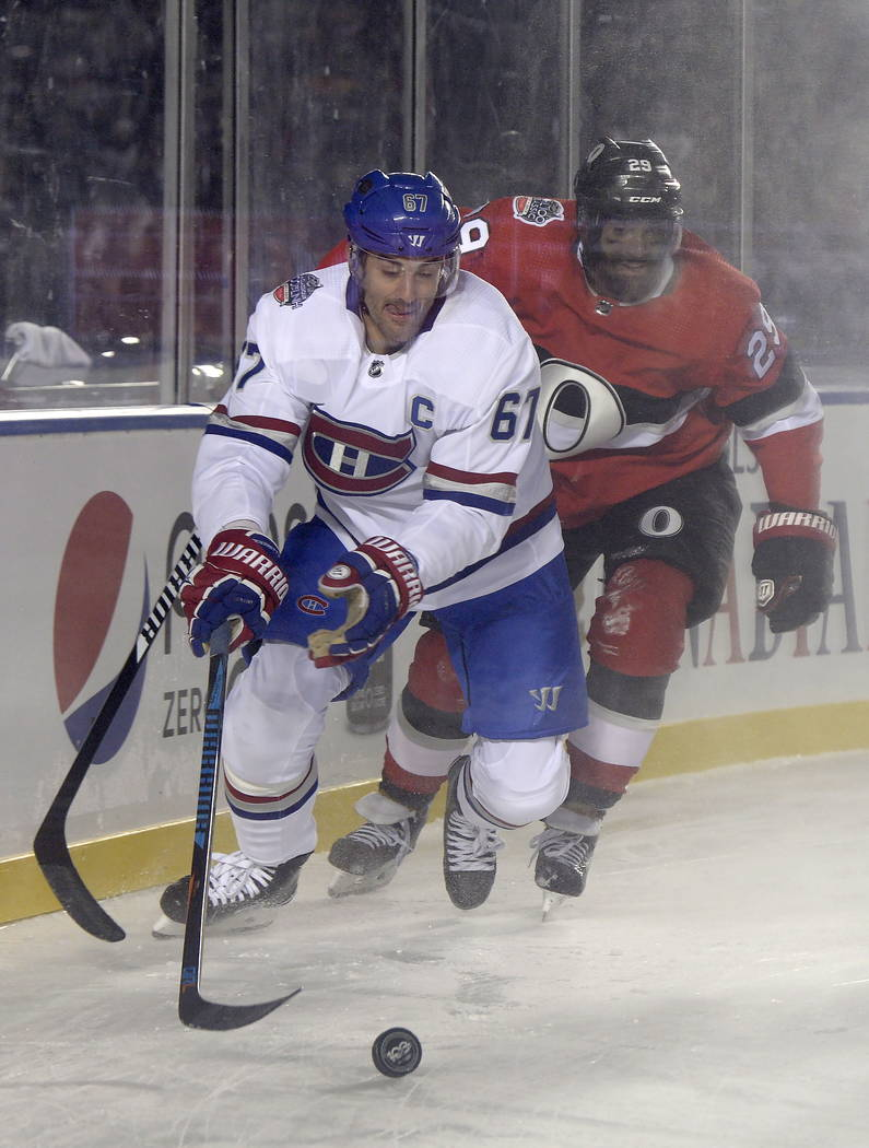 Ottawa Senators defenseman Johnny Oduya (29) gives chase as Montreal Canadiens left wing Max Pacioretty (67) goes in for the puck during first period hockey action at the NHL hockey 100 Classic in ...