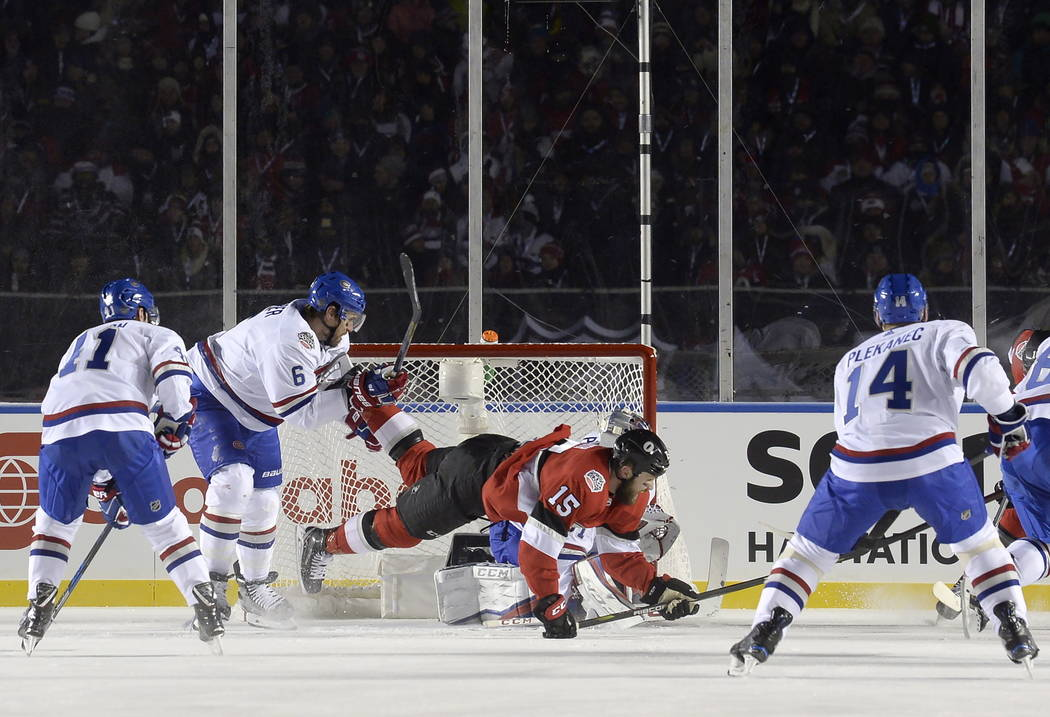 Montreal Canadiens defenseman Shea Weber (6) checks Ottawa Senators left wing Zack Smith (15) to the ice during first period hockey action at the NHL hockey 100 Classic in Ottawa on Saturday, Dec. ...