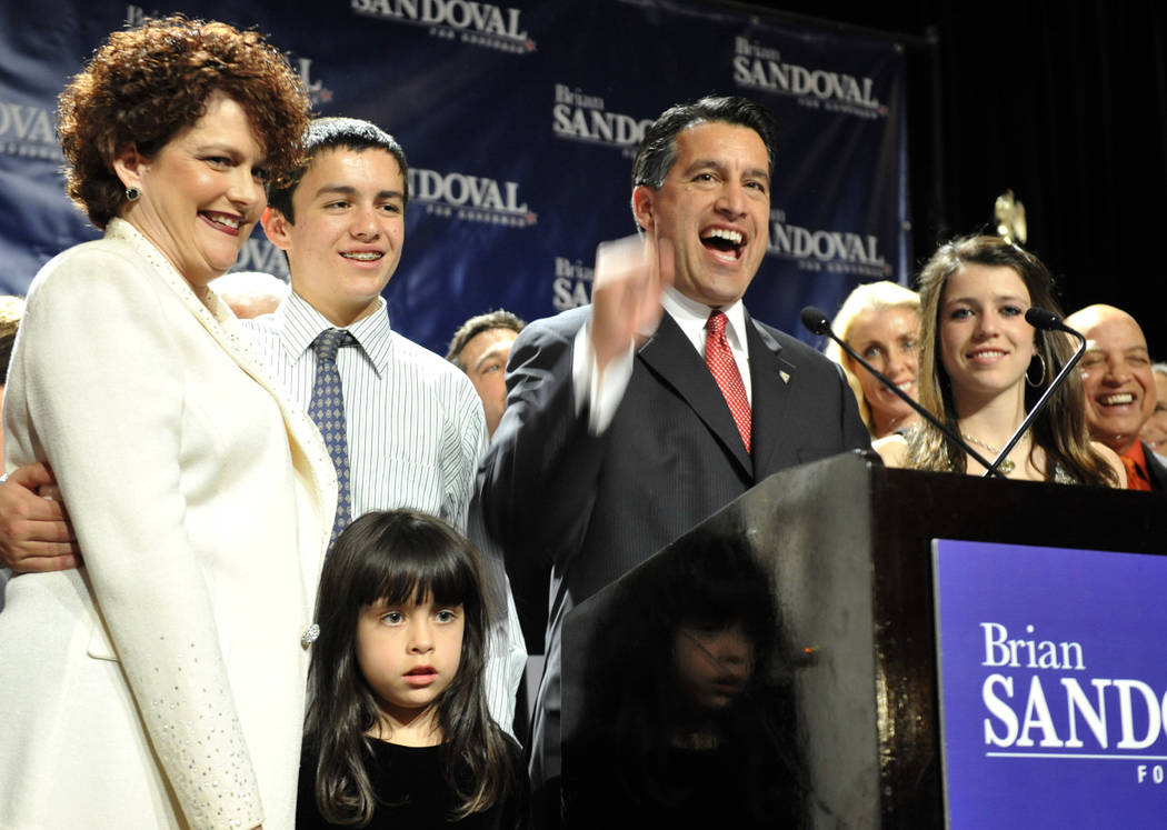 FILE - In this Nov.2,2010 file photo Republican Nevada gubernatorial candidate Brian Sandoval celebrates his victory with his family at an election night party, in Las Vegas. From left, Kathleen S ...