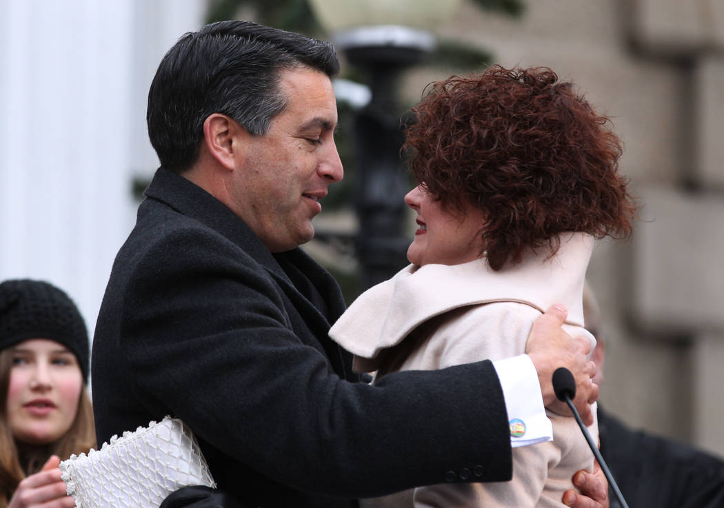 Nevada Gov. Brian Sandoval hugs his wife Kathleen after taking the oath of office during Monday's inauguration, Jan. 3, 2011 at the Capitol in Carson City, Nev. (AP Photo/Cathleen Allison)