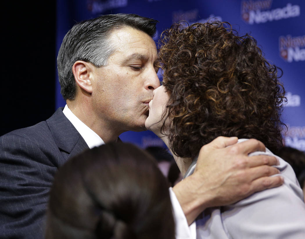 Nevada Gov. Brian Sandoval kisses his wife Kathleen Sandoval during a victory speech Tuesday, Nov. 4, 2014, in Las Vegas. Sandoval defeated Bob Goodman for governor of Nevada. (AP Photo/John Locher)