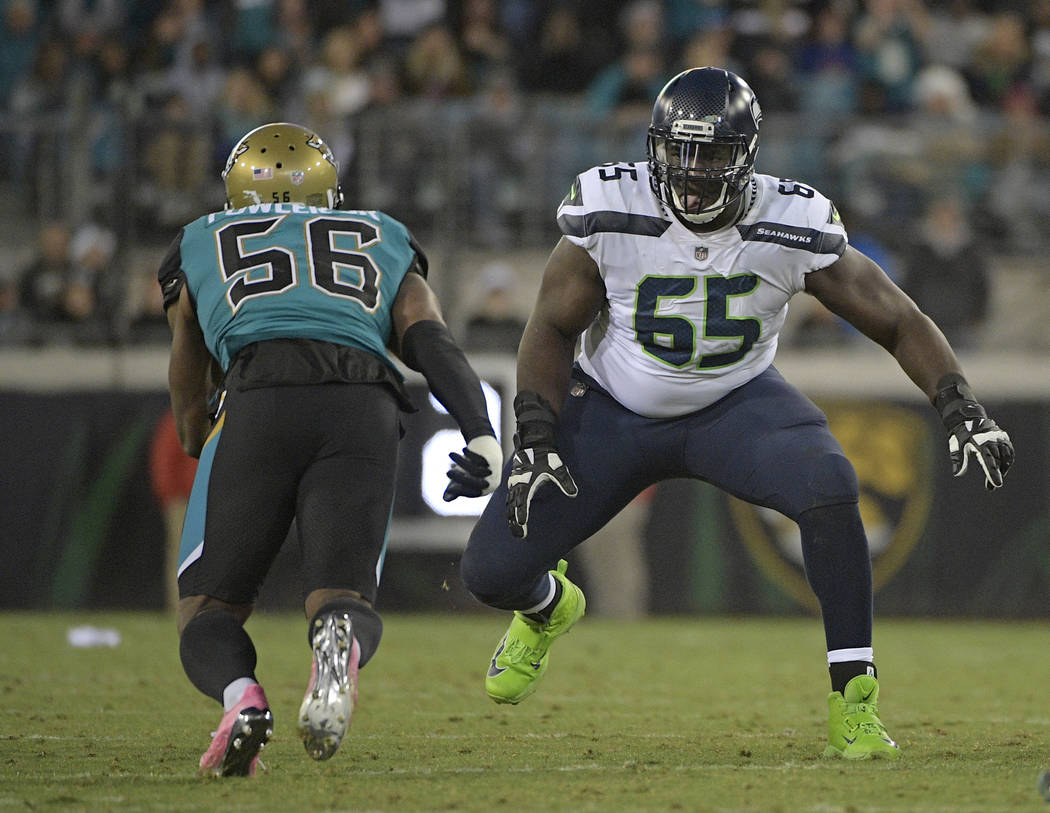 Seattle Seahawks offensive tackle Germain Ifedi (65) looks to block Jacksonville Jaguars defensive end Dante Fowler Jr., (56) during the first half of an NFL football game, Sunday, Dec. 10, 2017,  ...