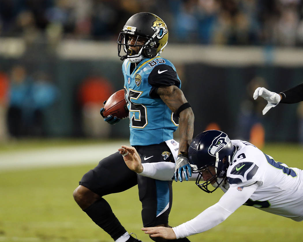 Jacksonville Jaguars wide receiver Jaydon Mickens, left, returns a punt for 72-yards ahead of Seattle Seahawks long snapper Tyler Ott, left, to set up a Jacksonville touchdown during the second ha ...