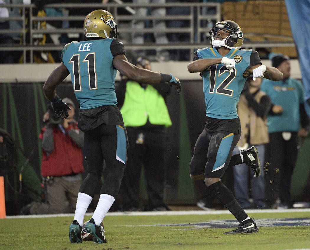 Jacksonville Jaguars wide receiver Dede Westbrook (12) celebrates his touchdown against the Seattle Seahawks with teammate wide receiver Marqise Lee (11) during the second half of an NFL football  ...