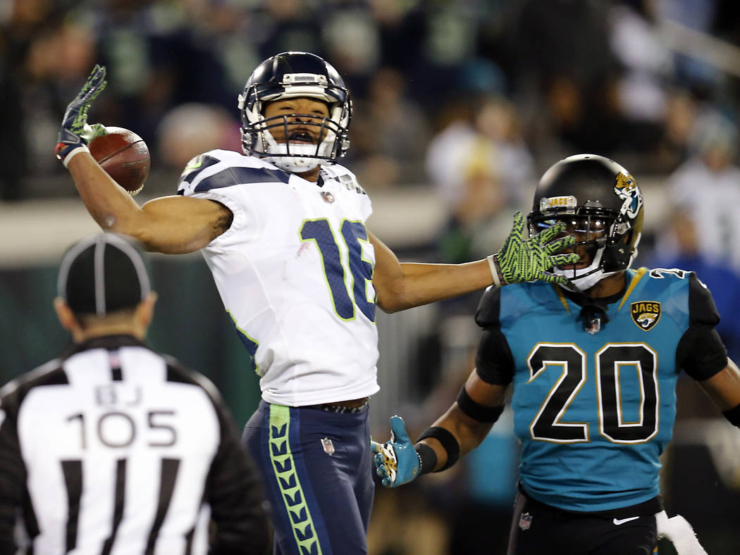 Seattle Seahawks wide receiver Tyler Lockett (16) can't make the catch in front of Jacksonville Jaguars cornerback Jalen Ramsey (20) during the second half of an NFL football game, Sunday, Dec. 10 ...