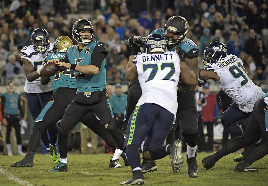 Jacksonville Jaguars quarterback Blake Bortles (5) throws a pass against the Seattle Seahawks during the second half of an NFL football game, Sunday, Dec. 10, 2017, in Jacksonville, Fla. (AP Photo ...