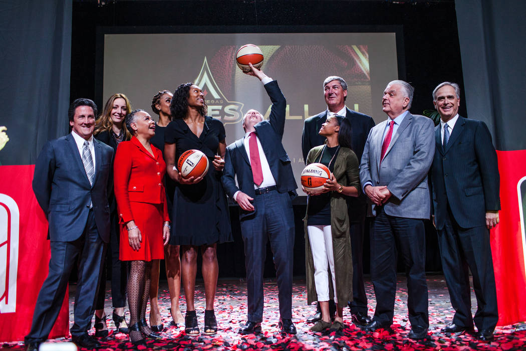 President of MGM Resorts International Bill Hornbuckle, left, WNBA President Lisa Borders, third from left, LaChina Robinson, fourth from left, Las Vegas Aces' Kayla Janine Alexander, fifth from l ...