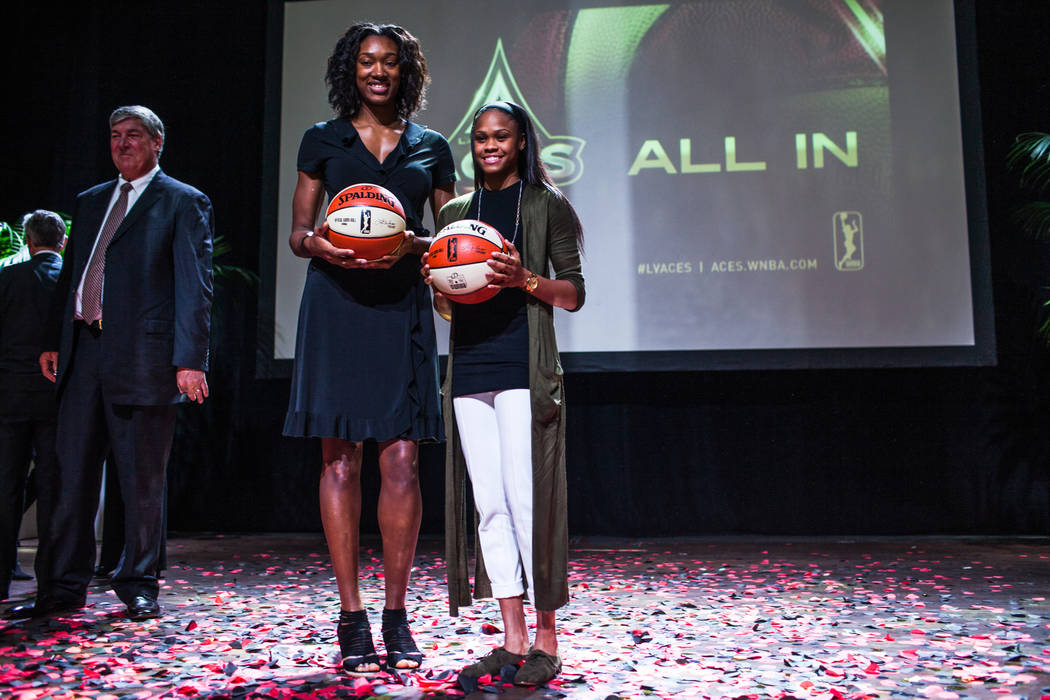 Las Vegas Aces' Kayla Janine Alexander, left, and Moriah Jefferson, right, gather during the reveal of the Las Vegas Aces WNBA basketball team at the House of Blues at Mandalay Bay in Las Vegas, M ...