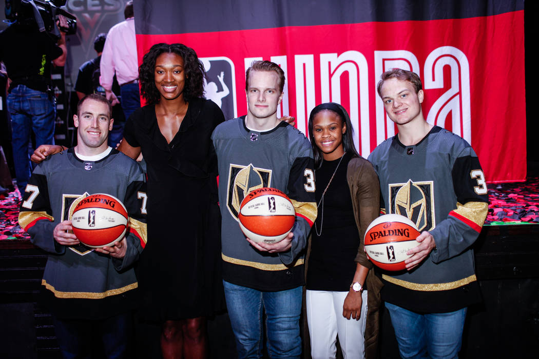 Vegas Golden Knights' Brad Hunt, left, Las Vegas Aces' Kayla Janine Alexander, second from left, Vegas Golden Knights' Oscar Dansk, center, Moriah Jefferson, second from right, and Vegas Golden Kn ...