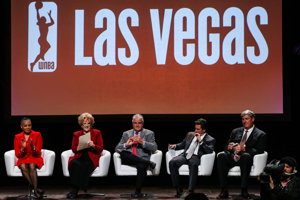 WNBA President Lisa Borders, left, Las Vegas Mayor Carolyn Goldmark Goodman, second from left, Clark County Commissioner Stephen Sisolak, center, President of MGM Resorts International Bill Hornbu ...