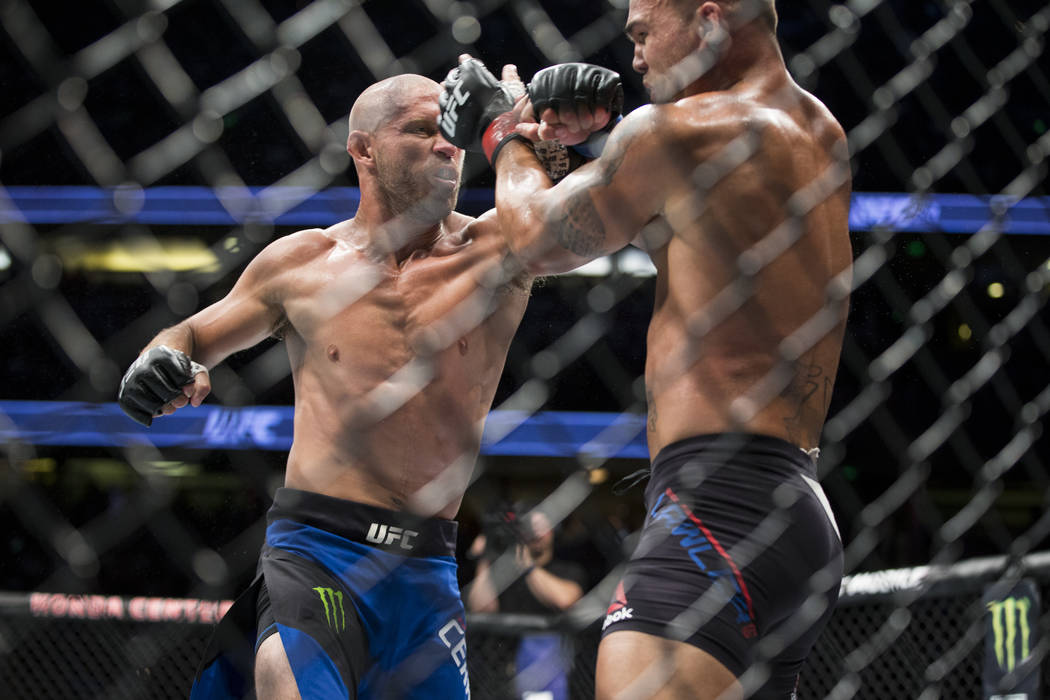 Donald Cerrone, left, battles Robbie Lawler in the welterweight bout during UFC 214 at the Honda Center in Anaheim, Calif., on Saturday, July 29, 2017. Lawler won by unanimous decision. Erik Verdu ...