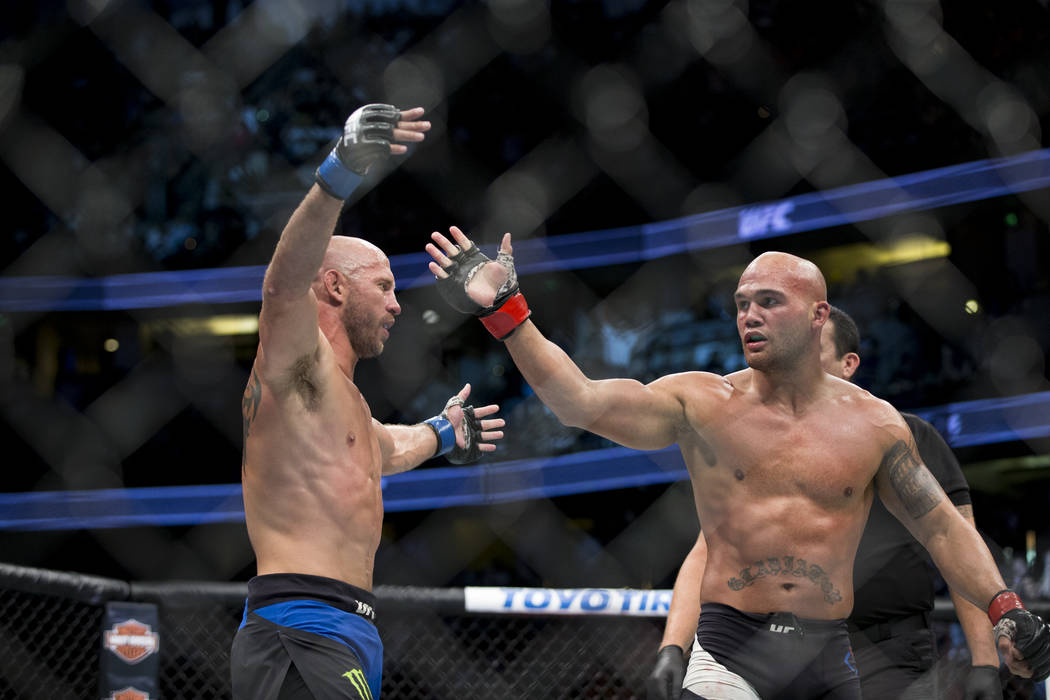 Donald Cerrone, left, and Robbie Lawler react to the end of the fight in the welterweight bout during UFC 214 at the Honda Center in Anaheim, Calif., on Saturday, July 29, 2017. Lawler won by unan ...