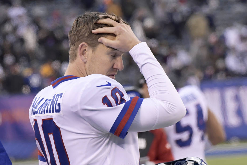 New York Giants quarterback Eli Manning (10) reacts from the bench during the fourth quarter of an NFL football game against the Dallas Cowboys, Sunday, Dec. 10, 2017, in East Rutherford, N.J. (AP ...