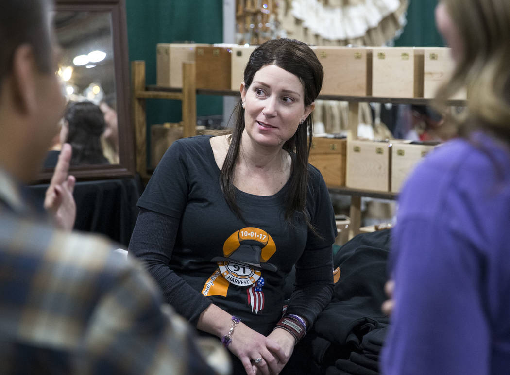 Natalie Grumet, who was shot in the face during the Route 91 Harvest festival, smiles while working at the Down N Dirty Hat Company booth during the Stetson Country Christmas expo at the Sand ...