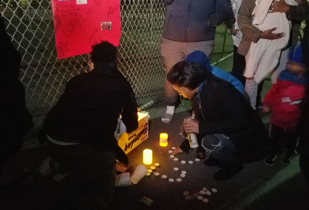 Family and friends gather for a vigil in remembrance of Carrie Williams-Smith and Jazzy Smith on Saturday outside of Sunrise Mountain High School in Las Vegas. (Mike Shoro/Las Vegas Review-Journal)