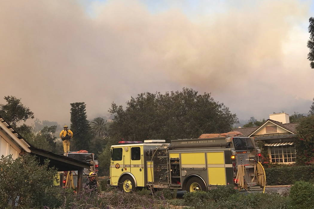 Fire engines provide structure protection at the historic San Ysidro Ranch in Montecito, Calif., Saturday, Dec. 16, 2017. (Mike Eliason/Santa Barbara County Fire Department via AP)