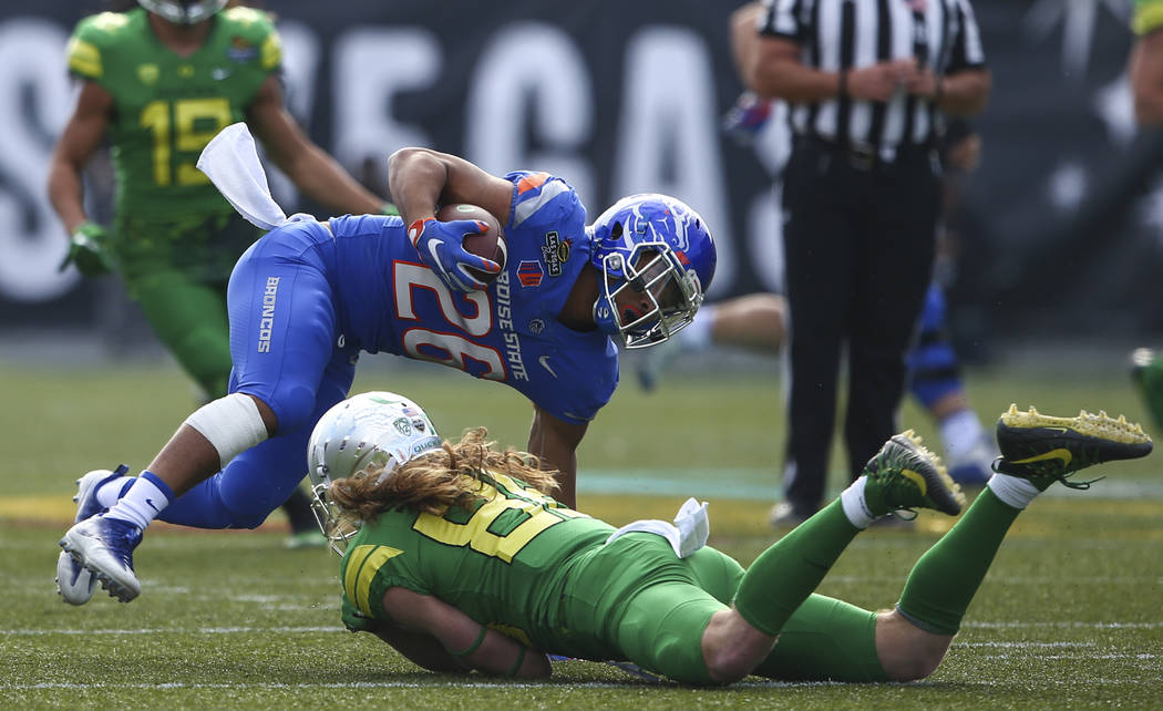 Boise State's Avery Williams (26) gets tripped up by Oregon's Brenden Schooler (86) during the Las Vegas Bowl at Sam Boyd Stadium in Las Vegas on Saturday, Dec. 16, 2017. Chase Stevens Las Vegas R ...