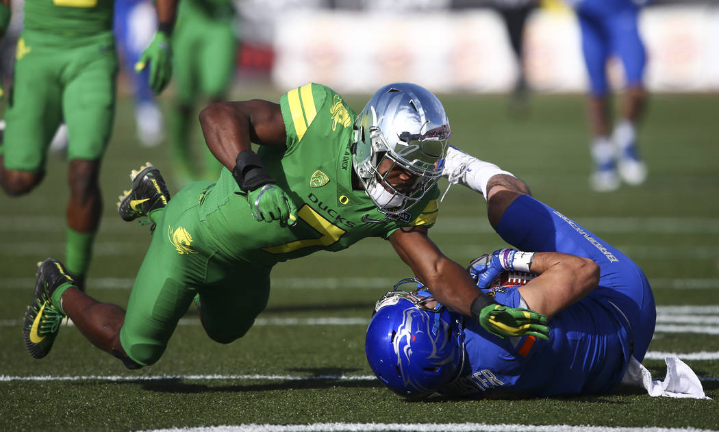 Boise State's Sean Modster (8) gets tackled by Oregon's Ugochukwu Amadi (7) during the Las Vegas Bowl at Sam Boyd Stadium in Las Vegas on Saturday, Dec. 16, 2017. Chase Stevens Las Vegas Review-Jo ...