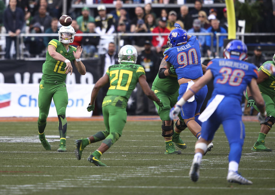 Oregon's Justin Herbert (10) passes the ball while playing against Boise State in the Las Vegas Bowl at Sam Boyd Stadium in Las Vegas on Saturday, Dec. 16, 2017. Chase Stevens Las Vegas Review-Jou ...