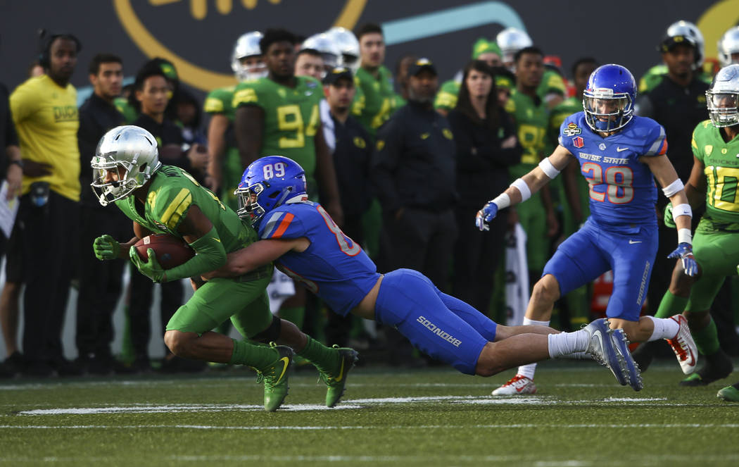 Boise State's Brock Barr (89) takes down Oregon's Dillon Mitchell (13) during the Las Vegas Bowl at Sam Boyd Stadium in Las Vegas on Saturday, Dec. 16, 2017. Chase Stevens Las Vegas Review-Journal ...