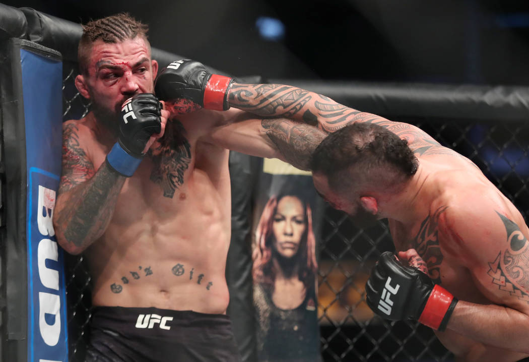 Dec 16, 2017; Winnipeg, Manitoba, USA; Santiago Ponzinibbio fights Mike Perry during UFC Fight Night at Bell MTS Place. Mandatory Credit: Bruce Fedyck-USA TODAY Sports