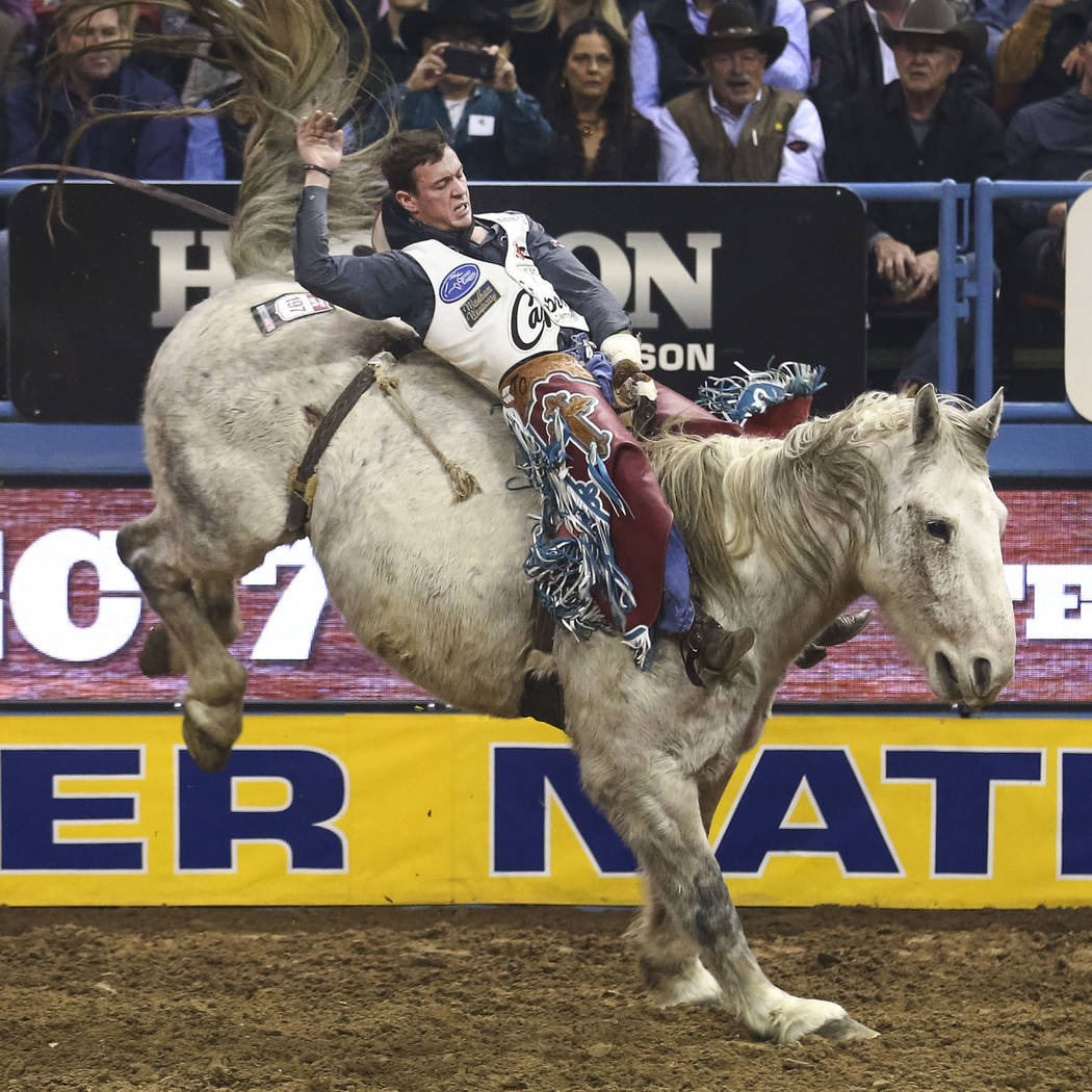 Tim O'Connell of Zwingle, Iowa rides Mucho Dinero in the bareback riding competition in the tenth go-round of the National Finals Rodeo, Saturday, Dec. 16, 2017, at the Thomas & Mack Center in ...
