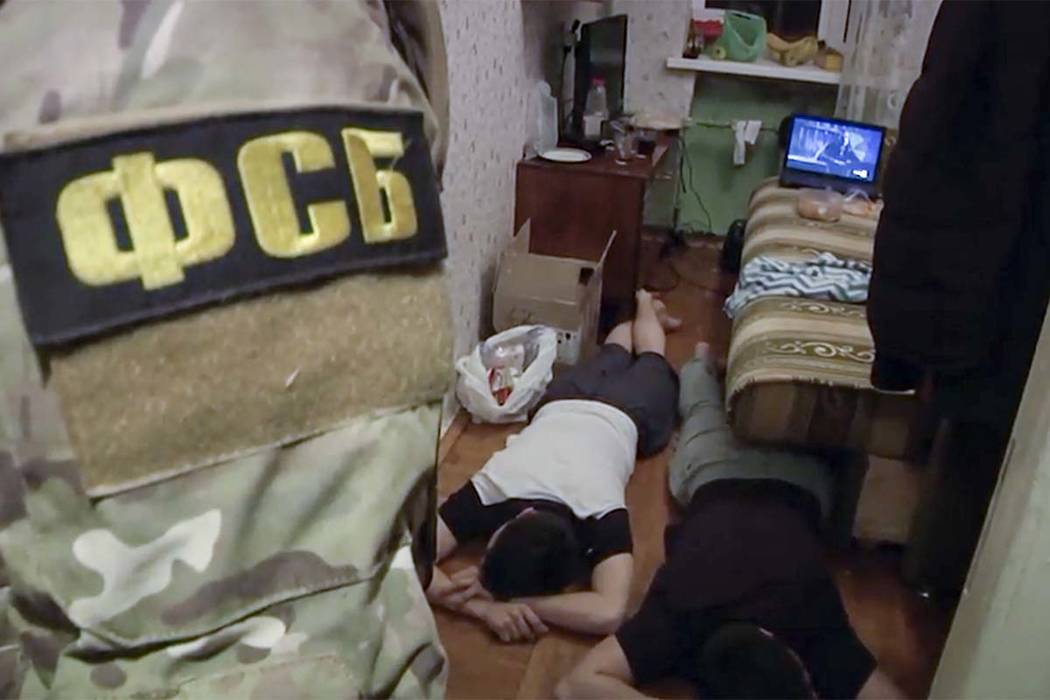 In this undated video grab provided by the RU-RTR Russian television via APTN in Moscow, Russia, Friday, Dec. 15, 2017,  Russian Federal Security Service operatives detain a suspected member of th ...
